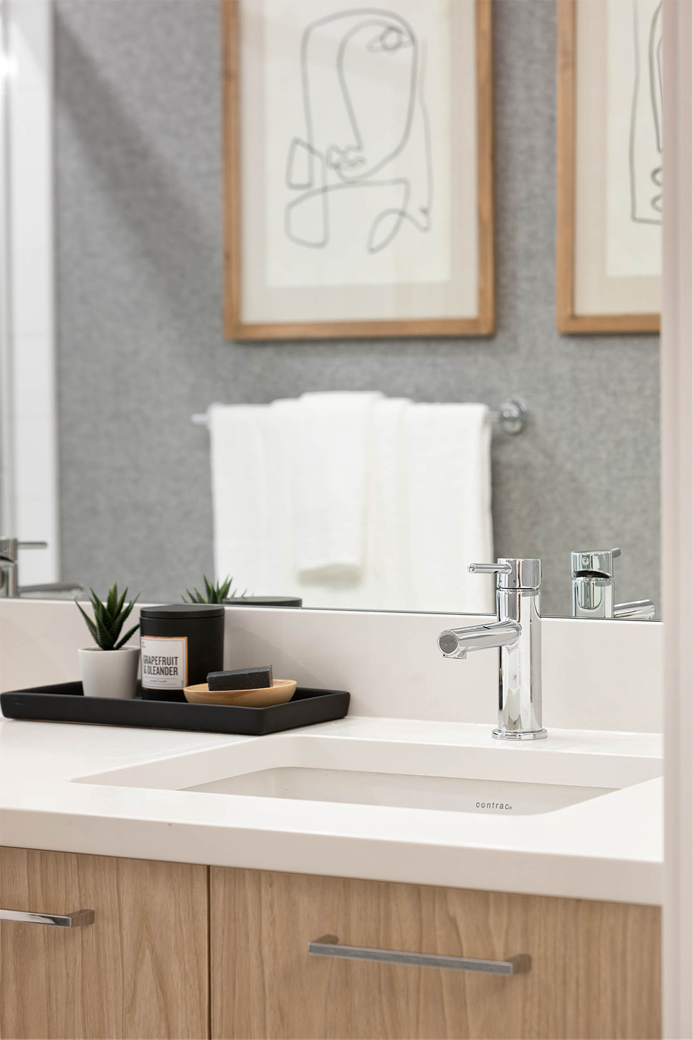 white sink with a silver faucet